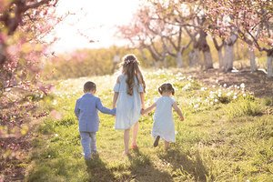 children in the orchard blossoms