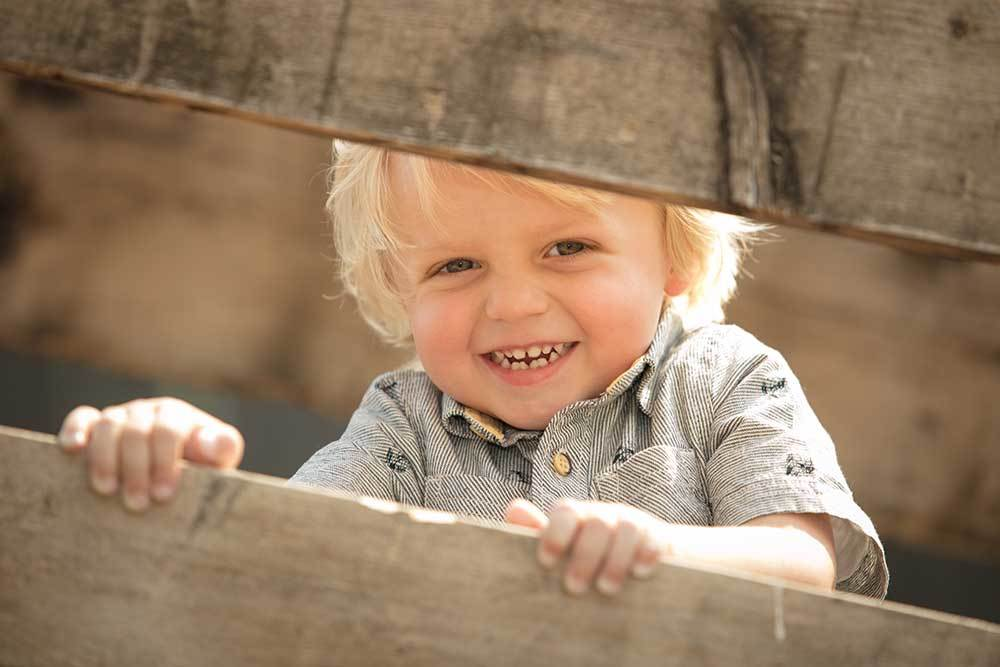 little boy portrait at a barn