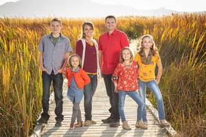 family portrait on a boardwalk