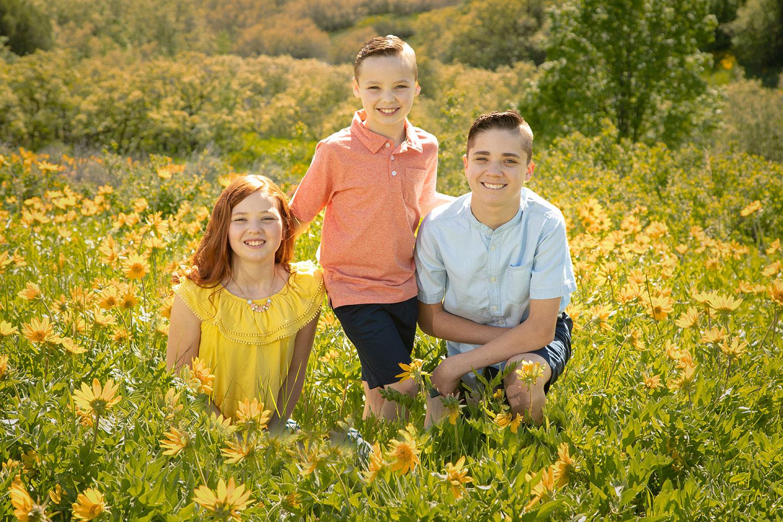 three kids in wildflowers