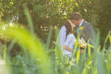 Peek over the grass and catch a wedding kiss.
